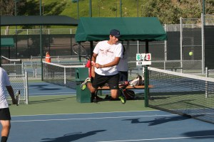 RCC freshman Antoine Voisin jumps high in an attempt to return the ball in his doubles match against Orange Coast on March 31