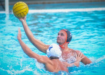Tigers' utility player, Kyle Christian takes a shot over Fullerton's player Andrew Schmidt at the Tigers' home game where Christian ended the game with five goals and two assists Oct 28, winning the match 20-9. (Stacy Soriano | Viewpoints)