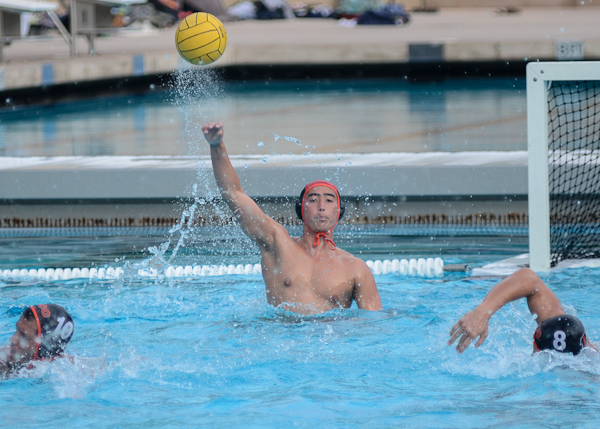 Tigers' goalkeeper Dustin Shaw throws the ball out after having one out of his seven saves of the game against Fullerton College on Oct. 28, where they defeated the Hornets 20-9. (Stacy Soriano | Viewpoints)