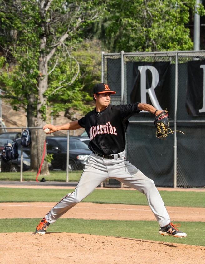 Tiger's pitcher, Andrew O' Brien, strikes out the side in the bottom of the eighth inning to help preserve the win for the Tigers against visiting Orange Coast College on April 19.