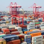 Piles of containers are pictured at a terminal of Yangshan Deep-water Port in Shanghai, China, 10 September 2013. (Photo via East Asia Forum)