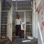 Former inmate on a return visit to his cell at Tripoli's Abu Salim prison where he was held for several years. (Photo by  Iason Athanasiadis/UNSMIL)