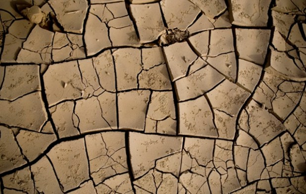 Dry earth in the desert plains of the Danakil depression in northern Ethiopia. For generic use, keywords: drought, famine, dry. (Photo by Siegfried Modola/IRIN)