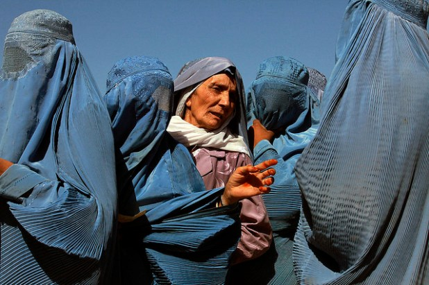 In Herat, Afghanistan, women line up to collect bags of split chick pea, wheat, and cooking oil being distributed by the UN World Food Program (WFP). (Photo by United Nations)
