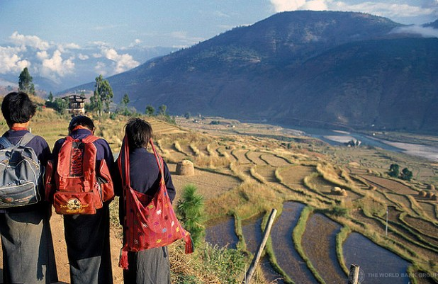 Children looking out on terraced fields in Bhutan. (Photo by World Bank Photo Collection)