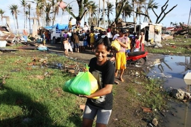 A young woman receives assistance in the typhoon-devastated town of Santa Rosa in Southern Leyte Province. More than 4 million people were displaced in the aftermath of Typhoon Haiyan, which slammed into the central Philippines on 8 November 2013. (Photo by David Swanson/IRIN)