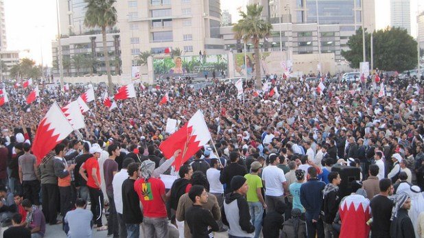 Anti-government protesters under the Lulu towers in Manama during the 2011 uprising. (Photo by Al Jazeera English, Creative Commons License)