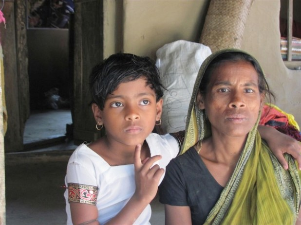 Jashoda Sarkar and her daughther, Jyoti Sarka, Hindus from a Bangladeshi village were attacked in poll violence. (IRIN photo by Mushfique Wadud)
