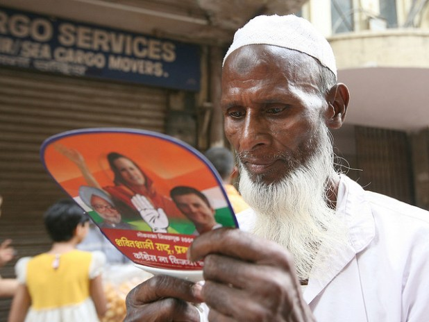 An Indian voter reads a political pamphlet distributed during a rally of the Indian National Congress in the western Indian city of Mumbai. (Photo by Al Jazeera English, Creative Commons License)