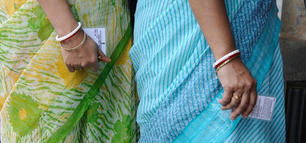 Indian women voters holding voting cards. (Photo by Al Jazeera English, Creative Commons License)