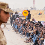 A Saudi security personnel stands guard at a migrant detention center in Jidda. (Photo via video stream)