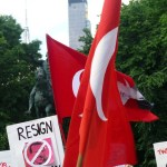 Protesters hold placards and Turkish flags at a protest rally at Union Square in New York in 2013. (Photo by Mike Licht, Creative Commons License)