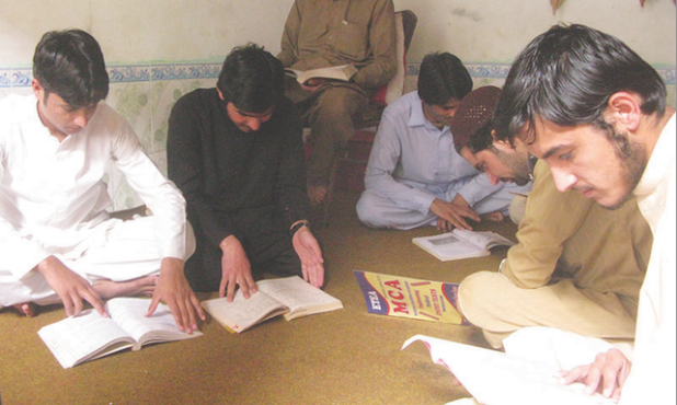 At a private educational refuge for Waziristan and Dawar students in Bannu, these young men spend much time preparing for their exams and keeping an eye on political developments back home. (Photo by Ihsan Khattak, via Dawn)