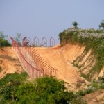 The Indian Border Fence along the Bangladeshi border along India's Meghalaya district. (Photo by lepetitNicolas, Creative Commons License)