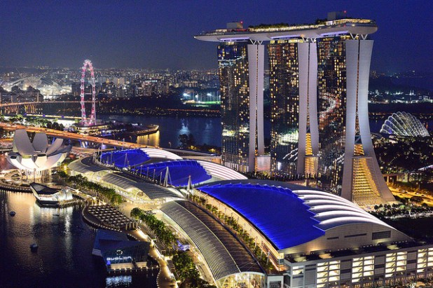 View from craft brewery Level 33, of Marina Bay Sands, Gardens by the Bay (right), Singapore Flyer (left) and the under construction Singapore Indoor Stadium (far left). (Photo by Peter Morgan, Creative Commons License)