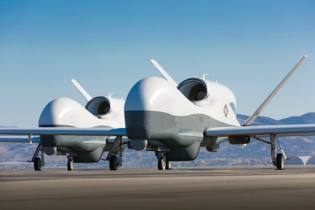 Two Northrop Grumman MQ-4C Triton unmanned aerial vehicles are seen on the tarmac at a Northrop Grumman test facility in Palmdale, Calif. (Photo by cmccain202dc, Creative Commons License)