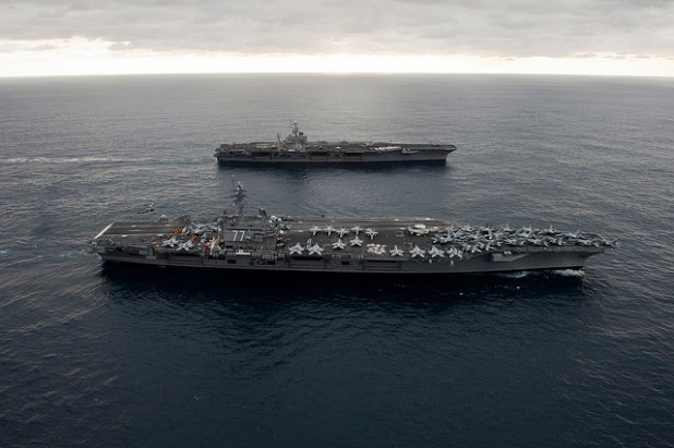 The US is preparing to send USS George H.W. Bush (front) to the Gulf in order to provide President Obama with military options in case the situation in Iraq worsens. (Official U.S. Navy page, Creative Commons License)