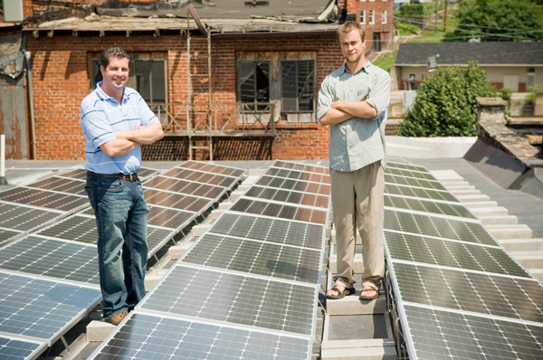 Dr. Dino Beckett (left) and Sustainable Williamson's Eric Mathis (right) on the town's Health and Wellness Center solar roof. (Photo by Lacey Ann Johnson, via OnEarth)