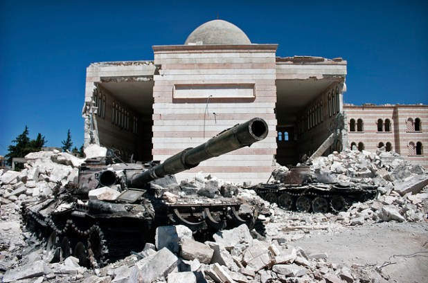 Two destroyed tanks in front of a mosque in Azaz, Syria. (Photo by Christiaan Triebert, Creative Commons License)