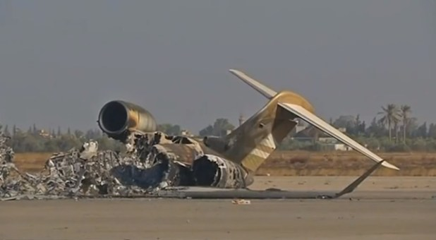 A destroyed passenger airliner at the Tripoli airport. (Photo via videostream)