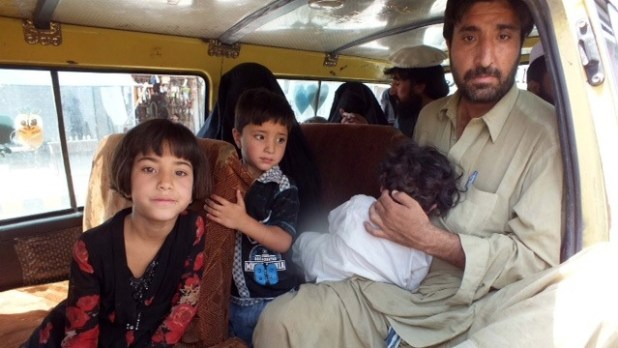 Families from North Waziristan traveling to Bannu. Pakistani security forces have setup checkpoints along the road.   (Photo by Umar Farooq/IRIN)