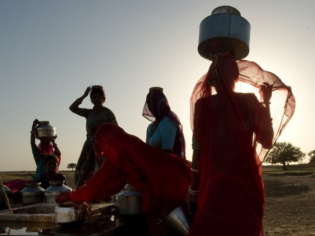 Women getting water from a well in India. (Photo by Arati Kumar-Rao, Creative Commons License)