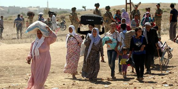 The fight for Kobani, a small Kurdish town on the Syrian side of the border between Turkey and Syria, has left thousands displaced. (Photo by Turgut Engin via Today's Zaman)