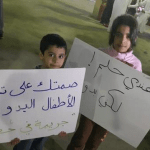 "More than 1,000 stateless children in Kuwait are not allowed to go to school. ""Your silence on preventing Bidoon children access to education is a crime,"" reads the placard on the left. The other one reads: ""I have a dream. But I am Bidoon."" (Photo shared on Twitter by @nawaf_alhendal)"
