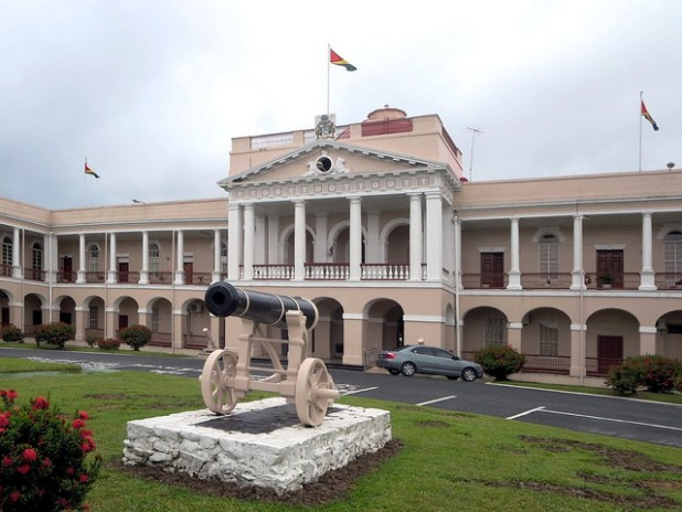 The neo-Classical Parliament Building in Georgetown, Guyana, is a monumental brick building completed in 1834. Two Russian cannon captured during the Crimean War grace the front lawn. (Photo by David Stanley, CC License)