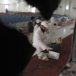 Forensic expert collecting evidence in Army Public School after TTP's barbaric terrorist attack. (INP photo Hussain Ali)