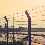 Fencing at India Pakistan border. Tensions have been rising between the two nuclear armed South Asian rivals in recent days. (Photo by Abhishek Baxi, Creative Commons License)