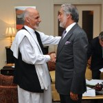 Afghan presidential candidate Ashraf Ghani, left, shakes hands with rival Abdullah Abdullah, right, at the U.S. Embassy in Kabul, Afghanistan on July 12, 2014, after U.S. Secretary of State John Kerry helped broker an agreement on a technical and political plan to resolve the disputed outcome of the election between them.  (Photo by U.S. Embassy Kabul, Afghanistan , Creative Commons License)