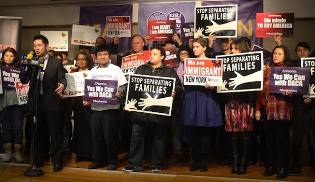 Steven Choi, executive director of NYIC opens the press conference and rally. Behind him, dozens of affected immigrants and advocates stand united against the Federal Judge's temporary delay of immigration relief.  (Photo by New York Immigration Coalition)