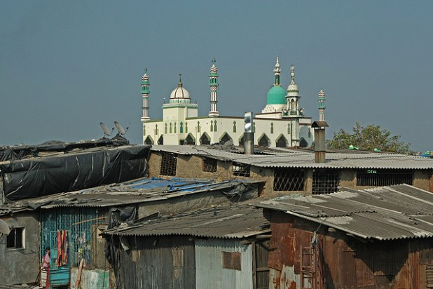 Housing and recycling units at Dharavi, Mumbai, flanked by a mosque. (Photo by Meena Kadri, Creative Commons License)