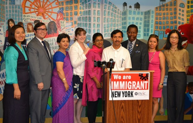 [left to right] Adhikaar campaign associate Sonam Dolker; director of the NYS Office of New Americans Jorge Montalvo; NYIC director of Legal Initiatives Camille Mackler; Adhikaar executive director Luna Ranji; Rabin Kumar, Adhikaar community members; Councilmember Mathieu Eugene; Rep. Joseph Crowley's director of immigrant affairs Mirna Velasquez; Mayor's Office of Immigrant Affairs policy director Sonia Lin.  (Photo courtesy NYIC)