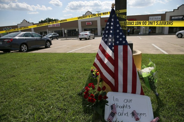 Police tape and a makeshift memorial frame the scene after a shooting at an Armed Forces Career Center in Chattanooga, Tenn. (Photo U.S. Navy photo by Damon J. Moritz/Released, Creative Commons License)