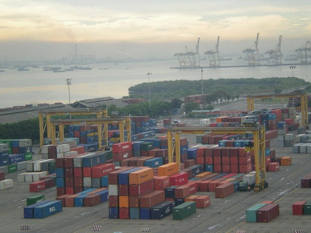 The container port in Surabaya is divided into import and export areas. Many Indonesian export goods like coffee are starting their journey around the world in this East Javan port. (Photo by BBC World Service, Creative Commons License)