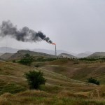 Dark smoke from a gas and oil fields near Ahwaz, Khuzestan province, Iran. (Photo by dynamosquito, Creative Commons License)