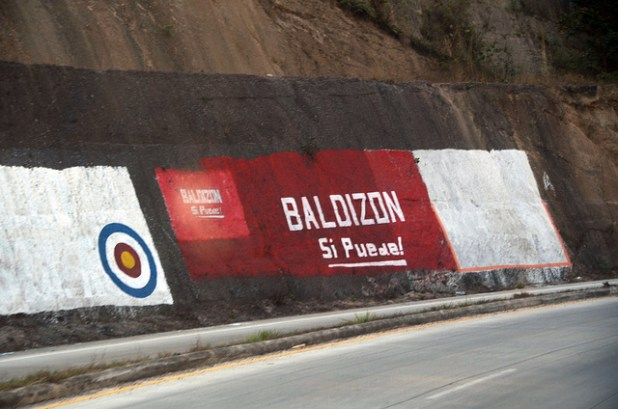 Political parties in Guatemala like to paint tree trunks, light poles, rocks and walls with the color of their political party. (Photo by David Amsler, Creative Commons License)