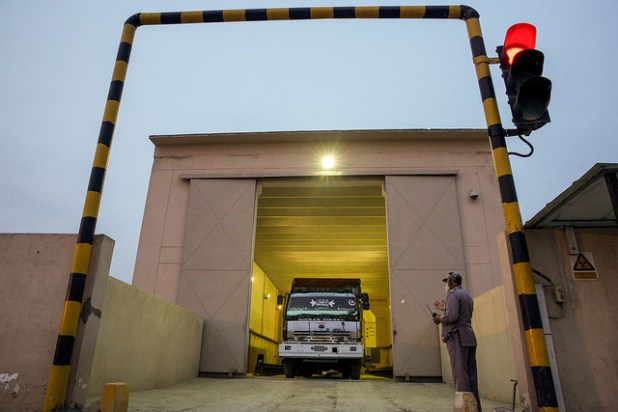 A staff at the Wagah Cargo Inspection Terminal checks a Pakistani truck arriving from India. (Photo by Asian Development Bank, Creative Commons License)