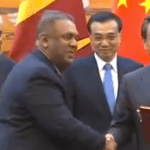 Chinese Premier Li Keqiang (2nd R) and Sri Lankan Prime Minister Ranil Wickremesinghe (2nd L) attend the signing ceremony of bilateral cooperation documents in Beijing, China, April 7, 2016. (Photo via cideo stream)