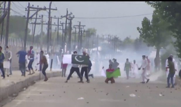 Anti-India protestors displaying Pakistan's flag during a protest in Srinagar, summer capital of Indian-administered Jammu and Kashmir region. (Photo via video stream)
