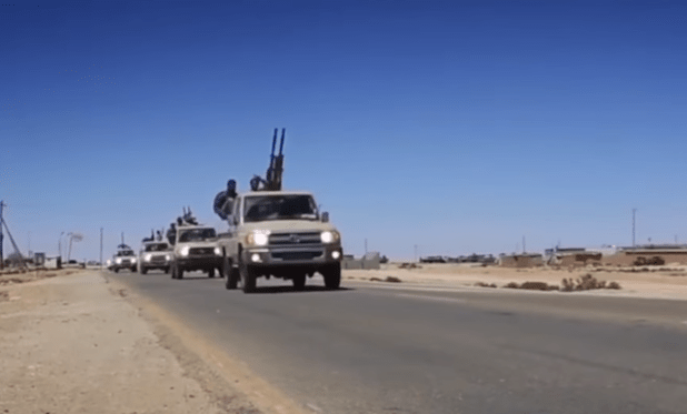 Forces loyal to General Khalifa Haftar of the Libyan Ground Forces on outskirts of Sirte preparing battle to liberate the city from the so-called Islamic State militants in May this year. (Photo via RT video stream)