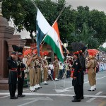 Pakistani and Indian troops lower their respective national flags at Wahgah border near the Pakistani city of Lahore. (Photo Michael Foley, Creative Commons License)