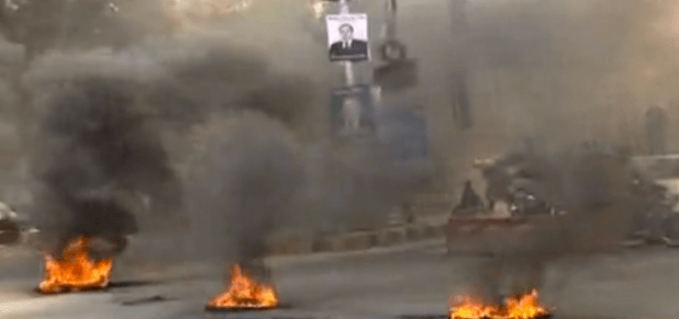 Protesters burn tires in Rawalpindi, Pakistan, during an anti-government protest. (Photo via video stream)