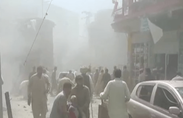 People remving the injured from the blast site in Parachinar after twin explosions on June 23. (Photo via video stream)