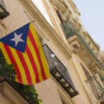 A Catalan flag flying out of an apartment balcony in Catalan region in Spain. (Photo by Jonathan Jones, CC license)