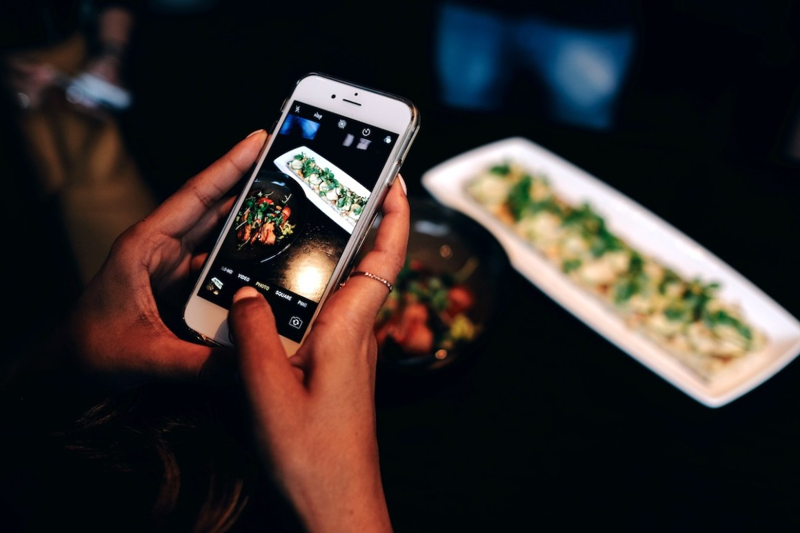 Mili Jain shooting the flatbread at Real Sports Bar & Grill - View the VIBE Toronto