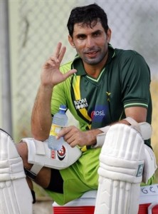Pakistan's cricket captain Misbah-ul-Haq  gestures to a teammate while taking a break during a training session in Georgetown, Guyana, Tuesday May 10, 2011. Pakistan and West Indies will square off in the first of two Test cricket matches beginning on Thursday. (AP Photo/Andres Leighton)