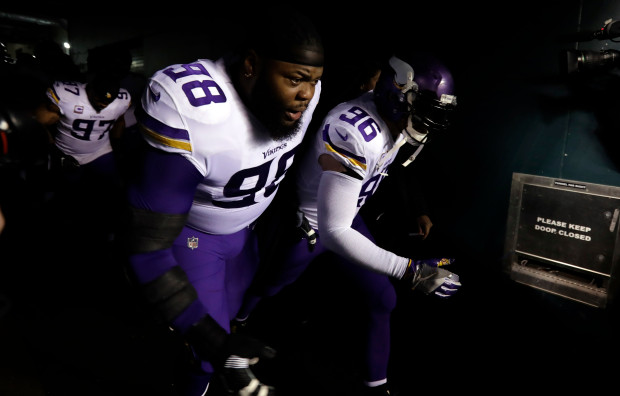 819bdf494 Minnesota Vikings  Linval Joseph and Brian Robison take the field before  the NFL football NFC championship game against the Philadelphia Eagles  Sunday